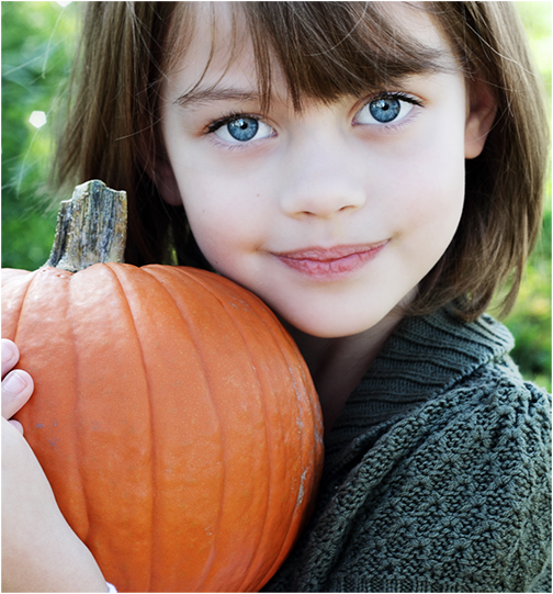 Cute girl with unsuspecting pumpkin