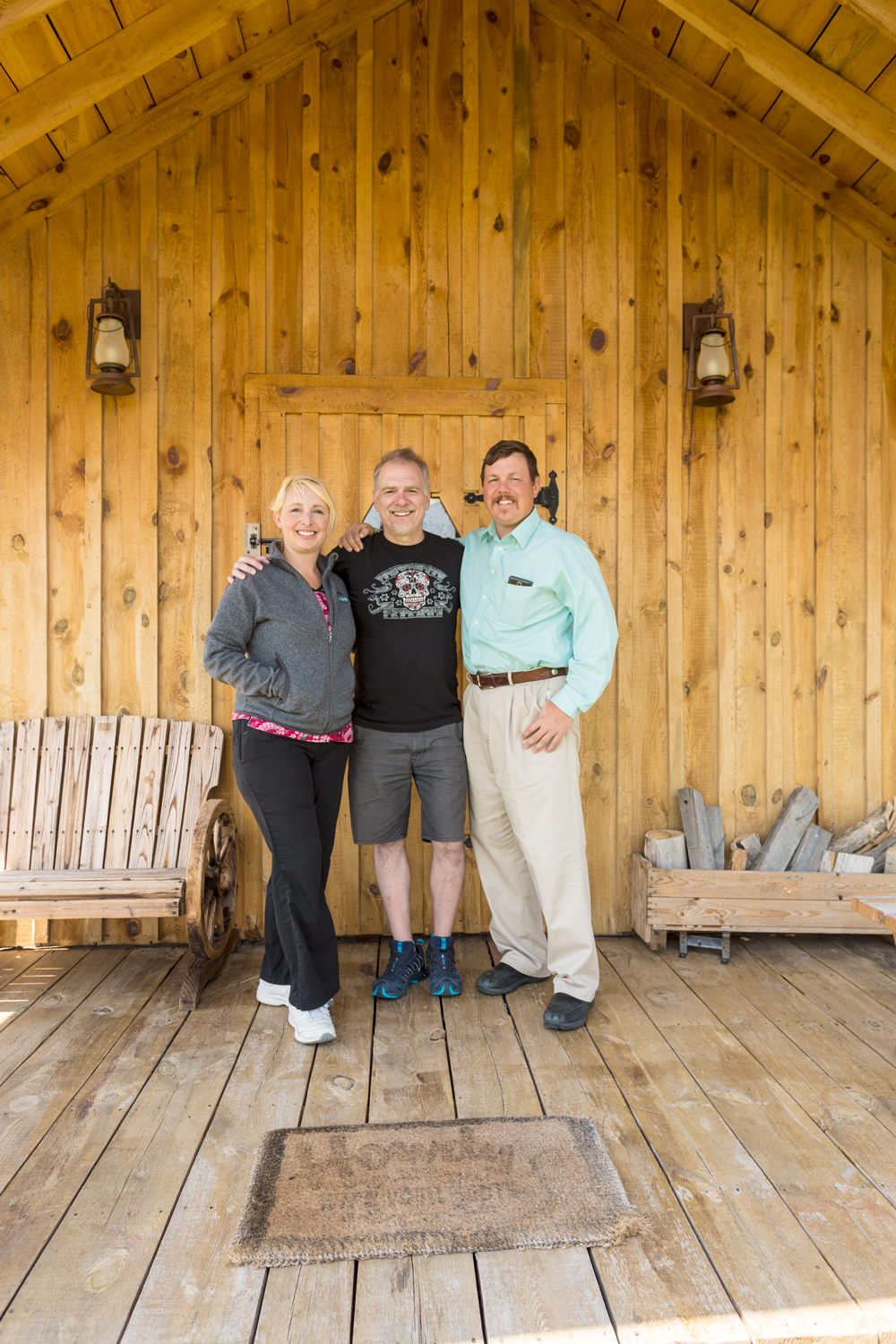 Stephanie and Tom with Deke in front of their Bunkhouse