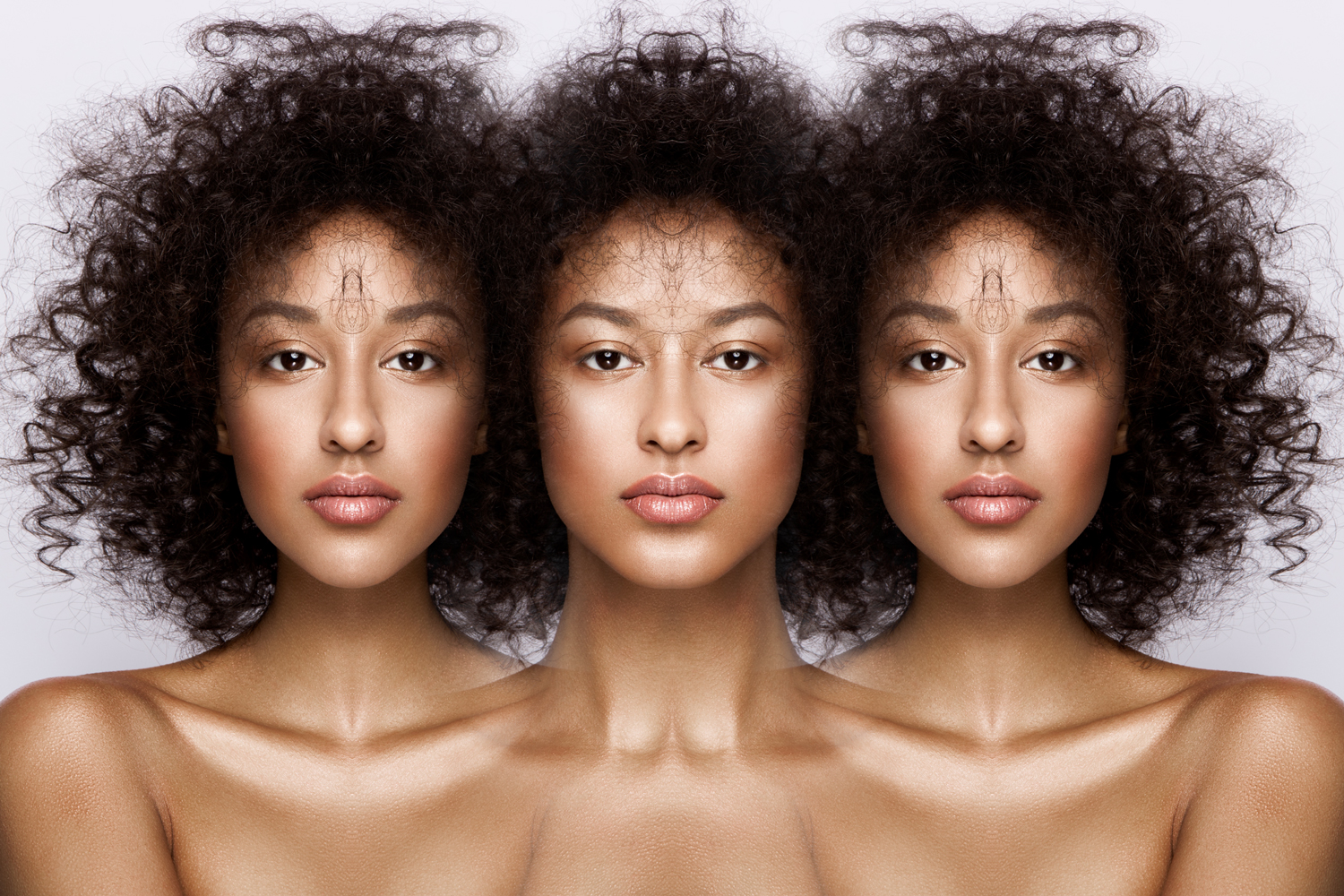 A triad of portraits containing symmetrical variations