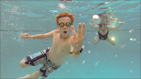GoPro photo of Max with three fingers, Colleen in the background