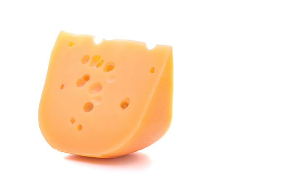 Swiss cheese on a stock white background