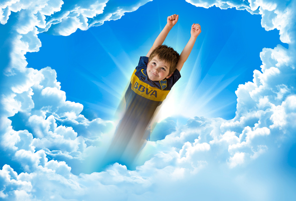 Boy flies through the clouds courtesy of Photoshop